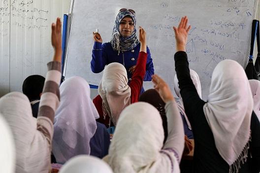 Syrian refugee children attend a class in a UNICEF school at the Al Zaatari refugee camp in Mafraq